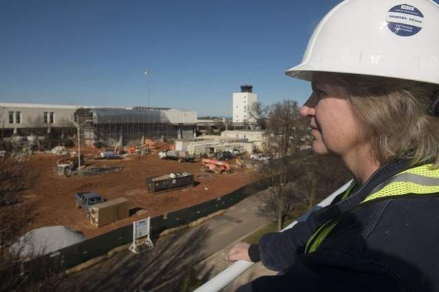 Tone Nichols' company, Tablerock Technologies, is installing solar panels as part of Greenville-Spartanburg International's $115 million terminal improvement renovation, a project Nichols hopes will boost her company's profile. / PATRICK COLLARD / Staff